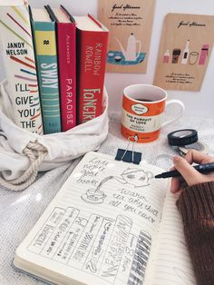 "bookishsmaug: "" Doodling, warm tea, stack of contemporary books, cozy sweater, cool mornings ☼ """