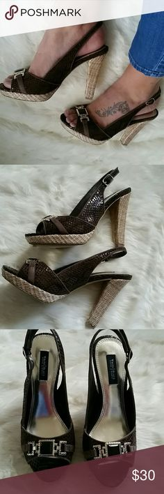 SALE! White House Black Market peeptoes Excellent used condition.  Only signs of wear are on the soles (last pic).  Brown snakeskin design with gold buckle across toe.  4.5 inch heel height and 3/4 inch platform. White House Black Market Shoes Platforms