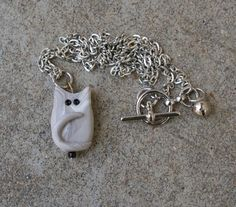 Cat Pendant with Bell by caldwali on Etsy  (An exclusive design of Magpie Designs. Copyright, 2013. All Rights Reserved.)
