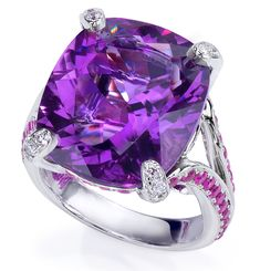 Cushion-shaped amethyst secured with 4 diamond pavé prongs, and mounted on a split shank, set with rows of pink sapphires and diamonds; in 18-karat white gold.