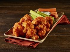 "CAULIFLOWER ""WINGS"" Crispy Buffalo-Style cauliflower served with bleu cheese, celery and carrot sticks."