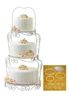 The three-tiered, scrollwork stand features crystal-clear plates which nest securely in each section. Ideal for garden-themed wedding cakes, but… Cake Stand Display, 3 Tier Cake Stand, Cake And Cupcake Stand, Themed Wedding Cakes, Wedding Cake Stands, Wedding Cake Toppers, Wedding Decor, Wedding Ideas, Wilton Cake Decorating Supplies