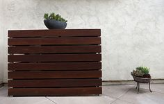 Modern Garden - IPE wood screen around AC - just around sides and have gaps between slats for air flow.