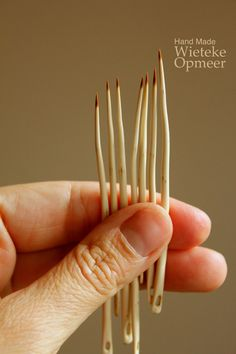 limited edition, wooden hawthorn needle, dark tip. by Wieteke Opmeer