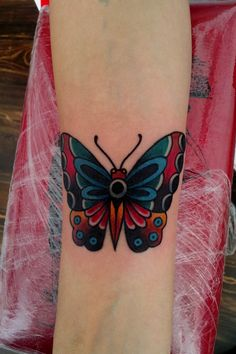 Clean, boldly colored statement tattoo. I really like this one!