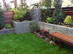 wooden bench with concrete wall for front yard - Snyder House: Hermosa Beach CA modern landscape