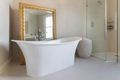 West One Bathrooms designed this master bedroom en-suite perfect for relaxing in. The solution by designer Laura Northeast was to combine a Victoria + Albert bath with an Antonio Lupi basin unit, Majestic shower enclosure and Geberit WC system to produce a subtle yet sophisticated scheme.