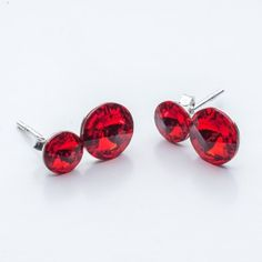 Swarovski Rivoli Earrings 6/8mm Light Siam  Dimensions: length:1,5cm stone size: 6mm and 8mm Weight ~ 1,60g ( 1 pair ) Metal : sterling silver ( AG-925) Stones: Swarovski Elements 1122 SS29 ( 6mm ) and SS39 ( 8mm )  Colour: Light Siam 1 package = 1 pair