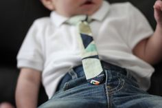 baby + skinny jeans + skinny tie = the perfect outfit Let's get started! Download the pattern page and print it HERE. Cut out the pieces and tape them together. Cut out two tie pieces. Trim one of the pieces down by 1/8″ on the long sides. Pin them together, matching the edges. One side …