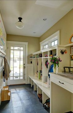 Mudroom Entry Design Ideas-05-1 Kindesign I have to say that a mudroom and large laundry room is the ONE thing I truly miss. Some of these are just spectacular.
