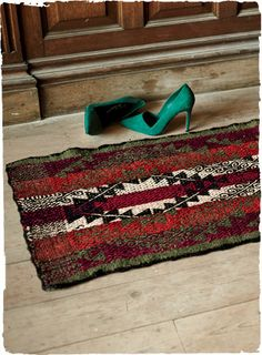Inspired by an Altiplano belt design, this stunning rug is handwoven in vegetal-dyed wool. Beautiful on the floor or atop a sofa or table.