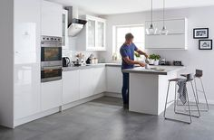 B&Q IT Santini Gloss White Slab. Our Santini Gloss White Slab kitchen combines simple lines with a smooth gloss finish for an ultra-minimalist look. Rustic Kitchen, New Kitchen, Kitchen Decor, Kitchen Grey, Kitchen Ideas, Kitchen With Grey Floor, Minimal Kitchen, Kitchen Hacks, Kitchen Inspiration
