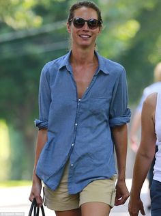 Model looks: Christy Turlington went with the casual look in shorts on Tuesday while strolling with a gal pal in the Hamptons in Long Island, New York