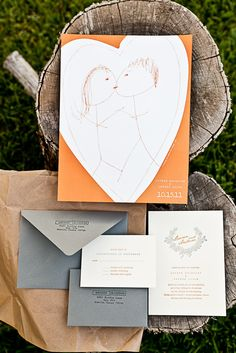 Orange and gray letterpress invitation. I love how the couple incorporated a stick-person sketch from one of their love notes! #orange #gray