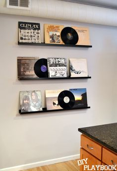 What to do with old records. Buy the picture frame ledges from Ikea and display all of your favorite albums!