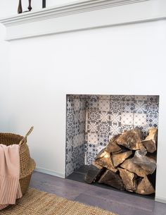 Like Rustic Meets Modern? You Need to See Inside This Toronto Home , Close up of tiled fireplace place insert with log pile. Empty Fireplace Ideas, Tv Over Fireplace, Brick Fireplace Makeover, Fireplace Hearth, Stove Fireplace, Fireplace Design, Fireplace Decorations, Unused Fireplace, Stucco Fireplace
