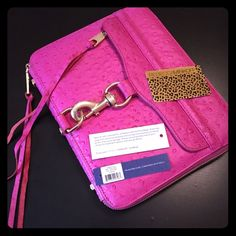 SIGNED Pink Rebecca Minkoff iPad 2 Leather Case SO AMAZING!! I absolutely love this hot pink leather iPad case SIGNED by Rebecca Minnoff, but I just don't use it enough. My loss is your gain! Comes with authenticity card and original price tag. There is some silver marker transfers on the inside as shown in photo three. No other signs of wear. Rebecca Minkoff Accessories Tablet Cases