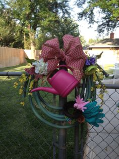 My husband was throwing away an old garden hose so I stopped him so I could use the hose to make a garden wreath. I cut the hose into two pieces so my daughter and I could both make one! This is the one Tiffany made!