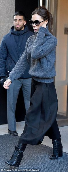 Simple but stunning: Victoria teamed her chunky knit with a pair of billowing black Aladdin-style culottes, showing off her structured boots
