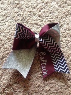 really cute bow and it shows my team colors  which are  maroon,grey and white  lets go Cameron Yoemen