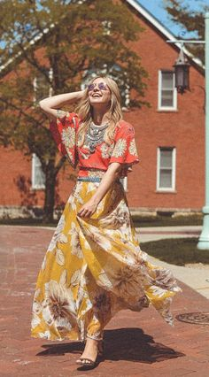 Marvel at the bold floral print of this gossamer maxi frock. Marvelous Floral Maxi Skirt in Yellow featured by LMPcollections Blog