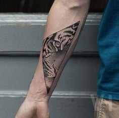 Geometric tiger tattoo by Valentin Hirsch