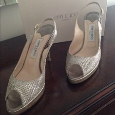Jimmy Choo Peep Toe High Heels Jimmy Choo peep toe high heels w/back strap, metallic color, size 38.5, comes with originals shoe box and dust bag. Mesh by front of peep toe is slightly lifted. I definitely got good use out of these shoes!! Super comfortable! Jimmy Choo Shoes Heels