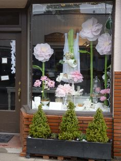 My front window (with my paper flowers) for our Spring Fling event.#window display, #retail display, #Emilys Garden