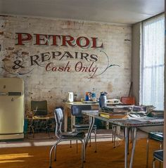 """This industrial kitchen has been inspired by typography and adverts of yesteryear. While I'd love to have the """"real thing"""" in my home, wouldn't this be a great painting for a wall?  Love this look!"""