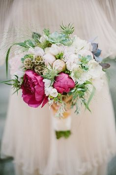 Pink peonies, scabiosa pods and succulents