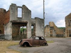 Oradour-Sur Glane, France,Burned out cars and buildings still litter the remains of the original village