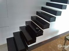 Interior floating stairs with metallic framework hidden into the wall.