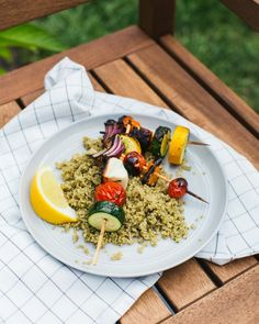 Need vegetarian grill recipes? These simple Greek grilled veggie skewers are served over pesto quinoa and are a healthy dinner idea ripe for summer.