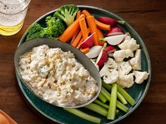 Onion Dip (No. 16) : Cook 2 thinly sliced onions in vegetable oil in a skillet over medium heat until golden, 35 minutes. Cool, chop and mix with 1 cup sour cream, 4 chopped scallions and salt to taste.