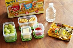 "Younger Kid Lunchtime Idea: ""Lunchtime Pizza"" Crackers, cheese & pepperoni with green grapes and a snack"
