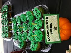 5 year old Army Birthday Party! Added green food coloring to the frosting and added edible metallic balls. The cupcake was yellow, green and brown cake mixes.