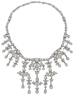 An Antique Diamond Necklace. Desiged as a row of graduated old-cut diamond links, centering on collet-set old-cut diamonds, suspending collet and pavé-set old-cut diamond garland motifs, mounted in silver-topped gold, length 14 inches. Via Phillips.