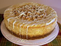 White Chocolate Pumpkin Cheesecake THIS WONDERFUL DELICIOUS CHEESECAKE  AND ONE YOU WILL LOVE. WITH THE CREAMINESS OF THE CAKE, ON TOP OF A GINGERSNAP COOKIE CRUST. TOPPED WITH TOASTED WALNUT AND A WHITE CHOCOLATE DRIZZLED. YUMMY. TAKE THIS TO YOUR NEXT CHURCH DINNER, YOU WILL SO GLAD THAT YOU DID...ENJOY