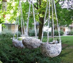 Hanging Plarn Planters, too bad I can't actually look at this site, cause it's spam!!  But I can at least look at the picture and go by that.