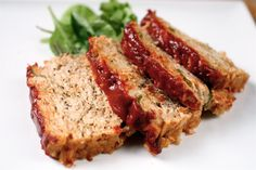 PALEO TURKEY MEATLOAF RECIPE - no breadcrumbs/almond meal! Recipe doesn't specify, but use one of the cans of tomato sauce in the meat mixture, and the other can (or part of the can) to pour on top before you bake.