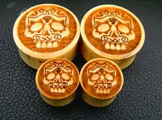 Sugar Skull Plugs(Pairs) Natural Wood, Organic Jewelry. Plug gagues 0g, 00g, 7/16 (Ask about larger sizes). $12.00, via Etsy.