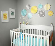 When Stephanie Avey set out to design the nursery, she didn't have much of a plan, but she knew that she wanted white furniture to go with her gray nursery. She added yellow and teal to the color palette and came up with this eclectic room for her baby son.