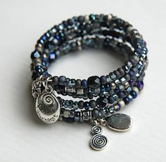 Memory wire bracelet with blues, blacks and silver.