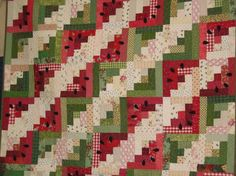 cute watermelon quilt made with log cabin blocks, perfect for summer!