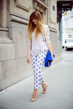 beige jacket grey top white ankle skimming print pants electric blue bag and nude pointy heels
