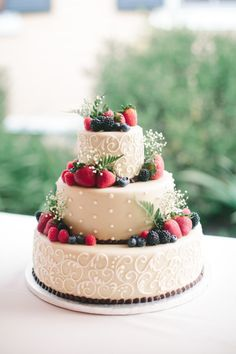 Fondant + fresh fruit wedding cake {Ashley Largesse Photography}
