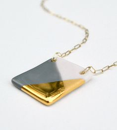 Ashjewelrystudio. Large square porcelain necklace, gold-dipped on Etsy  Materials: porcelain, glaze, gold overglaze, 14k gold filled chain