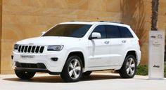 2015 Jeep Grand Cherokee Overland. White. Tinted windows. Black rims.