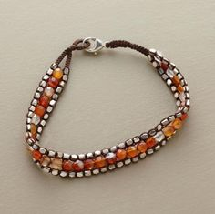 "color!  	  carnelian parade bracelet    Danielle Welmond weaves together a multicolored parade of faceted carnelians amid borders of sterling silver beads. Lobster clasp. Hand woven with silk in USA. Approx. 7""L.     398.00"