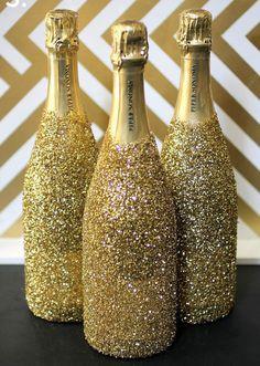 Des bouteilles de Champagne en or - paillettes